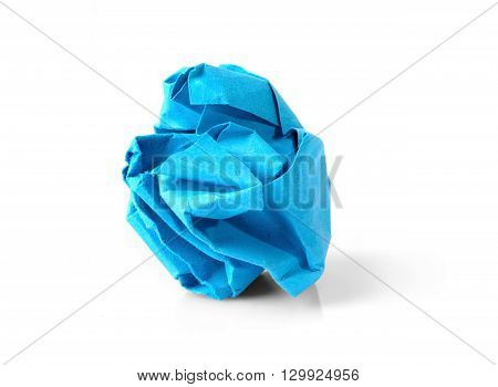Blue wrinkled paper ball isolated on white background symbol of recycling and wasting our resources.