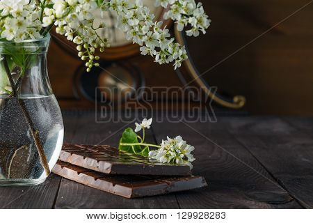 Chocolate And Flowers Of Cherry-bird With Cup Of Coffee, Selective Focus