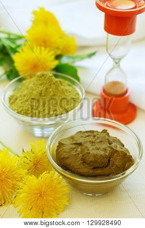 Henna powder. Henna paste. Prepare henna paste. Prepare the henna paste at home. Still life with henna dandelions and hourglass.