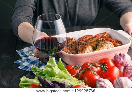 Women Hand holding bowl barbecue chicken on table