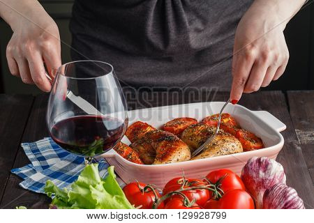 Woman Puts Roast Chicken On The Table