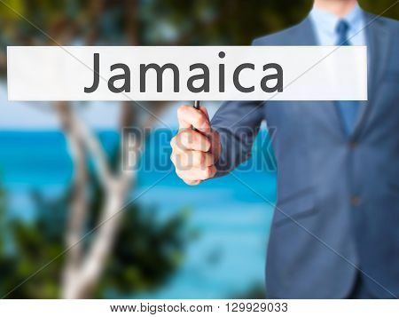 Jamaica - Businessman Hand Holding Sign