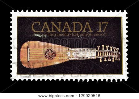 CANADA - CIRCA 1981 : Cancelled postage stamp printed by Canada, that shows Old musical instrument Mandora.