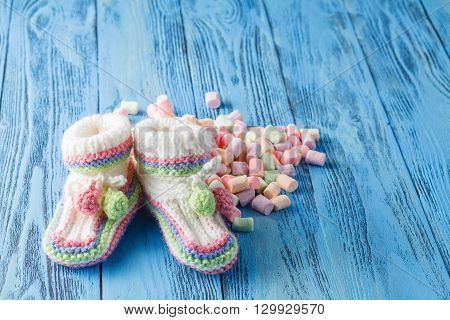 Baby Birthday Announcement. Infant Booties With Sweets
