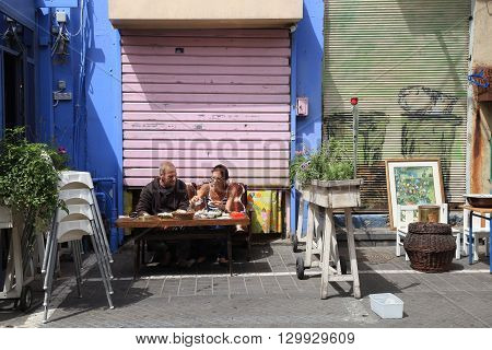 TEL AVIV, ISRAEL - APRIL 5, 2016: Local people eating in the flea market neighborhood of old Jaffa, Tel Aviv, Israel.
