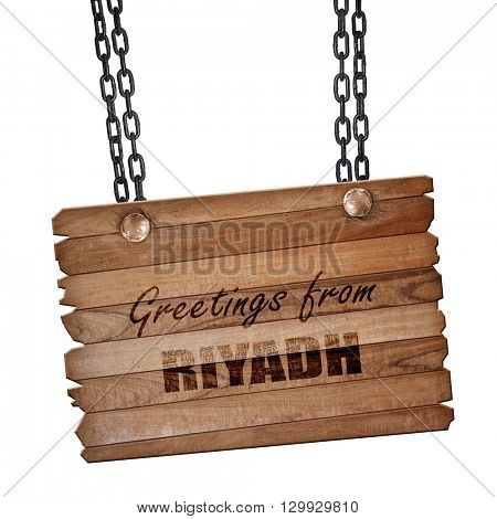 Greetings from riyadh, 3D rendering, wooden board on a grunge ch
