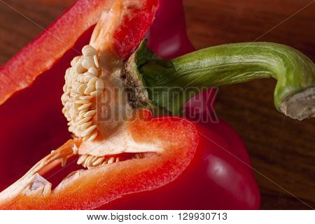 lying cut on a chopping Board red pepper. Visible grains of pepper