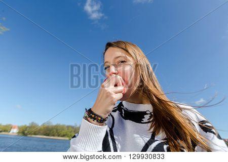 A Woman Enjoys An Apple