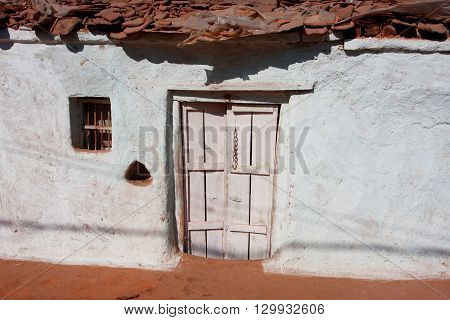 White door of house in small indian town of Madhya Pradesh India