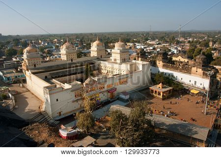 MADHYA PRADESH, INDIA - DEC 20, 2012: Sunny day above the historical hindu Ram Raja Temple on December 20, 2012 in Orchha India. The daily number of visitors to the temple range from 1500 to 3000 people.