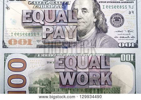 equal pay for equal work concept made from metallic letterpress type on US dollar banknotes