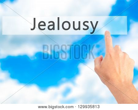Jealousy - Hand Pressing A Button On Blurred Background Concept On Visual Screen.