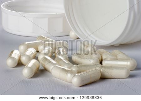 Capsules on white container in the side
