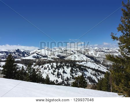 Snow filled ountain landscape on a clear winter day.