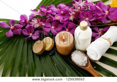 Spa set with towel, orchid on palm