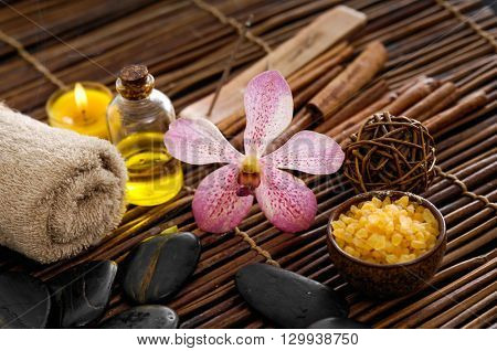 Handmade soap with towel, orchid,stones on bamboo mat