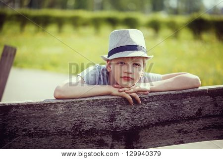 Young attractive handsome boy wearing a hat
