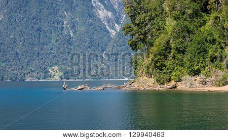 Beautiful Esmeraldo Lake (Emerald Lake) , Port Montt  Chile. Gateway to Chili's Lake District. Snow capped volcanoes