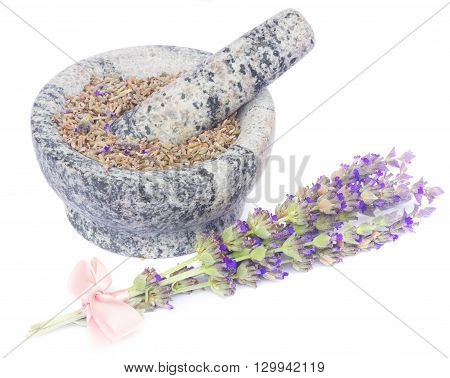 Lavender  posy with pink ribbon  and mortar with dry flowers   isolated on white background