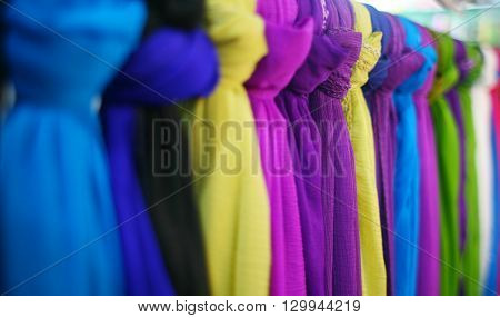 shopping, industry, sale and clothing concept - colorful textile at asian street market