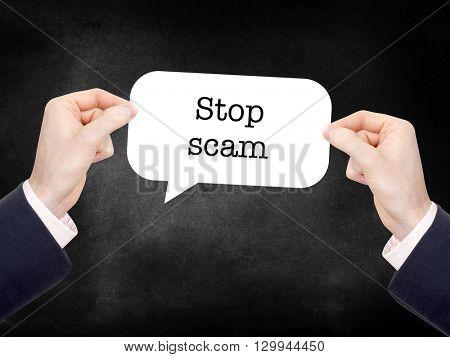 Stop scam written on a speechbubble