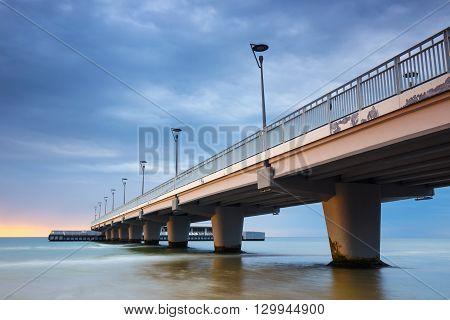 Concrete Pier In Kolobrzeg, Long Exposure Shot At Sunset