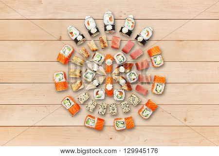 Japanese food restaurant, sushi california gunkan roll plate or platter set. Sushi at wooden planks background. Top view, flat lay. Big party sushi set.