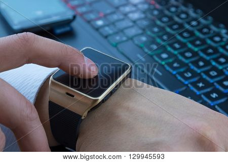 Business Man Using Smartwatch App Near Pc Keyboard And Smartphone
