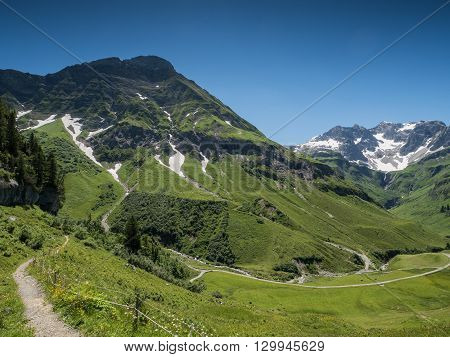 A view of Alpine mountains and the Koerbersee lake near the village Schroecken in Bregenzerwald region Vorarlberg Austria