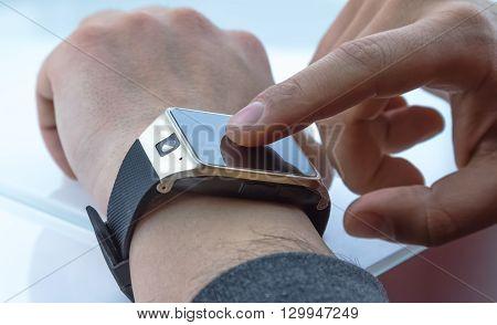 Man Using Smartwatch App