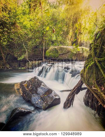Vintage retro effect filtered hipster style image of tropical waterfall Phnom Kulen, Cambodia