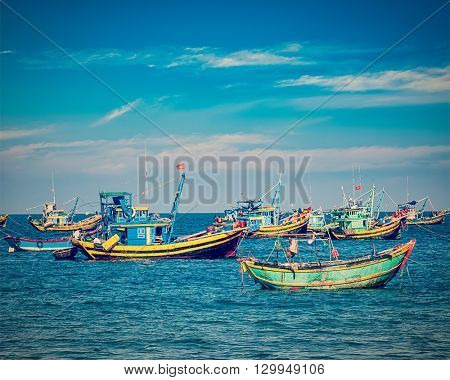 Travel Vietnam - vintage retro effect filtered hipster style image of  fishing boats in Mui Ne, Vietnam