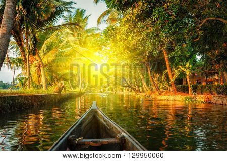 Kerala backwaters tourism travel in canoe on sunset. Kerala, India