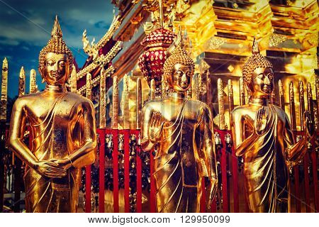 Travel Thailand Buddhism religion - vintage retro effect filtered hipster style image of gold Buddha statues in Wat Phra That Doi Suthep, Chiang Mai, Thailand