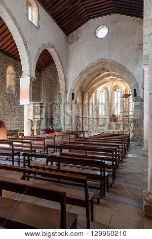Santarem, Portugal. September 11, 2015: The nave, aisle and altar of the medieval church of Santa Cruz. 13th century Gothic Architecture. Santarem, Portugal.
