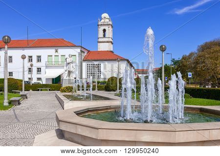 Santarem, Portugal. September 11, 2015:  Infante Santo Square. In background, the Escola Pratica de Cavalaria, a military cavalry quarter and the former Trindade Convent tower.