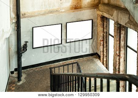 Grunge building with two picture canvas frames, mockup photo frame