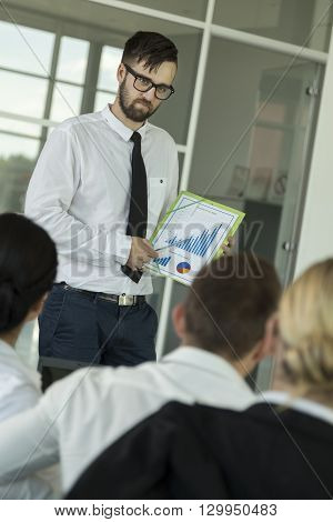Young successful business man presenting the results of the latest project he has been worikng on