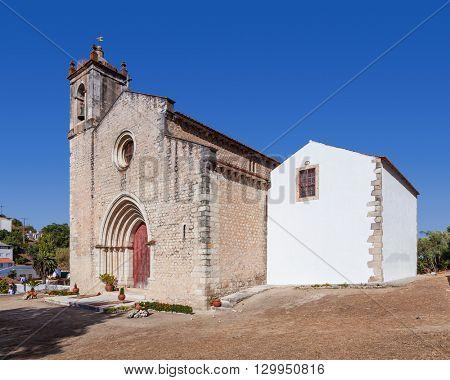 Santarem, Portugal. September 11, 2015: The medieval church of Santa Cruz with a Gothic portal. 13th century Gothic Architecture. Santarem, Portugal.