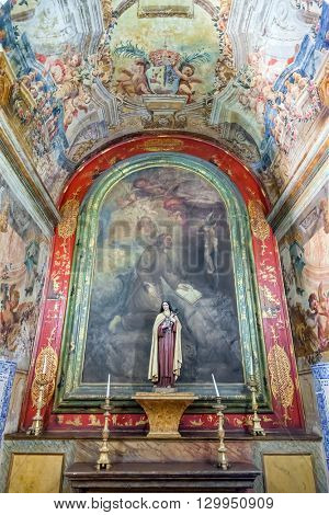 Santarem, Portugal. September 11, 2015: One of the chapels covered with frescos in the nave of the Hospital de Jesus Cristo Church. 17th century Portuguese Mannerist architecture, called Chao.