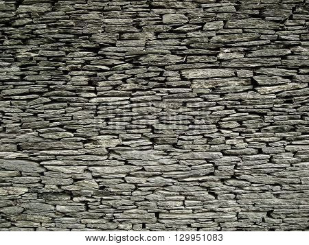 The texture of the stone wall of slate