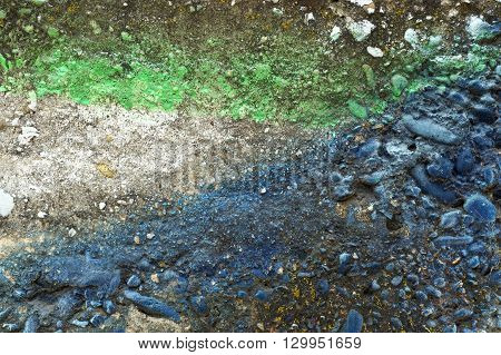 Dirty Grey Concrete Wall With Blue Colored Stones 12