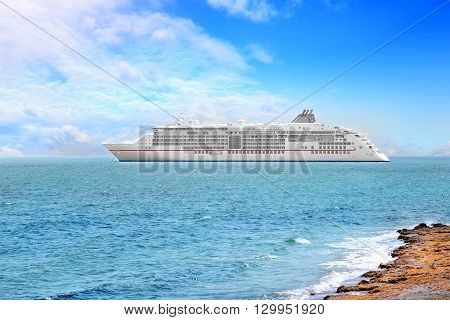 Big cruise ship in the sea at sunny day.