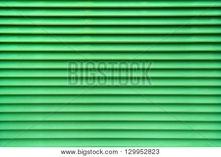 Green abstract background of air vent in horizontal pattern