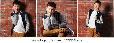 Fashion collage. Cute little boy standing near brick wall