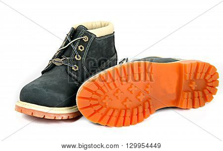 Pair of Brown lady's boots with shoelace and sole up on white background.