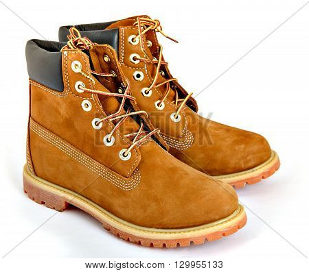 Pair of Brown lady's boots with shoelace on white background.