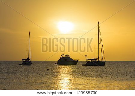The caribbean sea sunset and sailboats Martinique island; French West Indies.