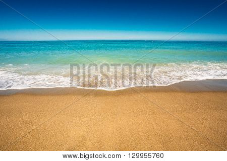 Soft Sea Ocean Waves Wash Over Golden Sand Background. Sea water and sand