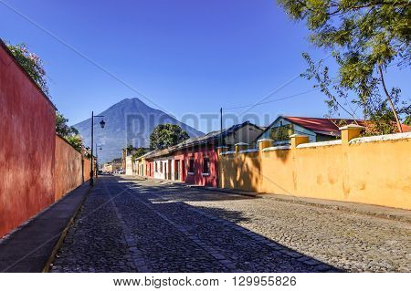 Antigua Guatemala - October 5 2014: Old colorful painted houses & Agua volcano in colonial city & UNESCO World Heritage Site of Antigua.